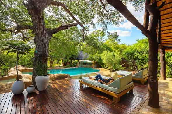Unwind on the Chapungu Luxury Tented Camp pool deck.