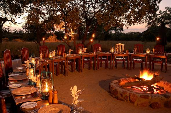 Dinner is served around the Jackalberry Safari Lodge boma.