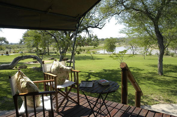 Relax and unwind on the Nkelenga Tented Camp porch.
